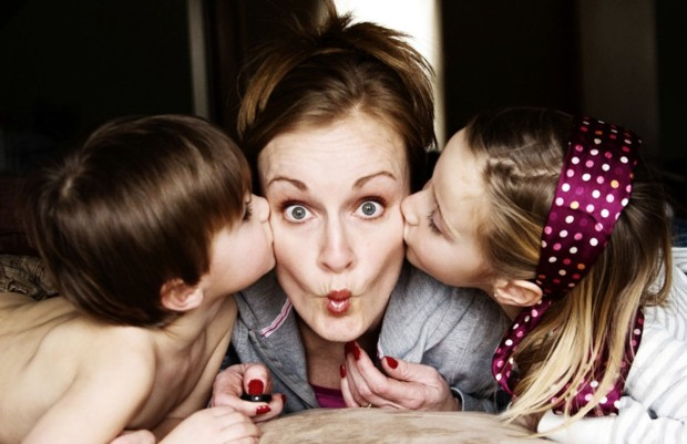mom-with-kids-kissing